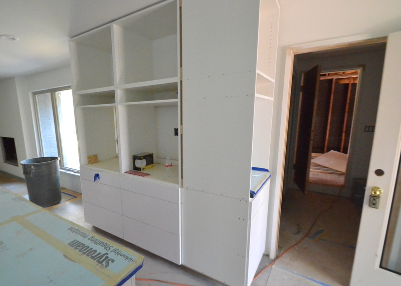 In the kitchen, Central Texas Custom Cabinets continues to install drawer fronts to the cabinets.