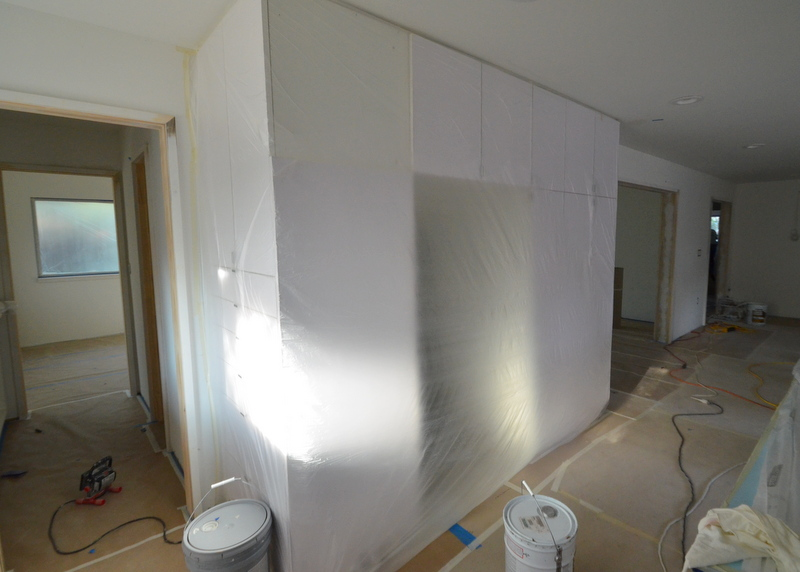 Here's the kitchen, wrapped in plastic sheeting.