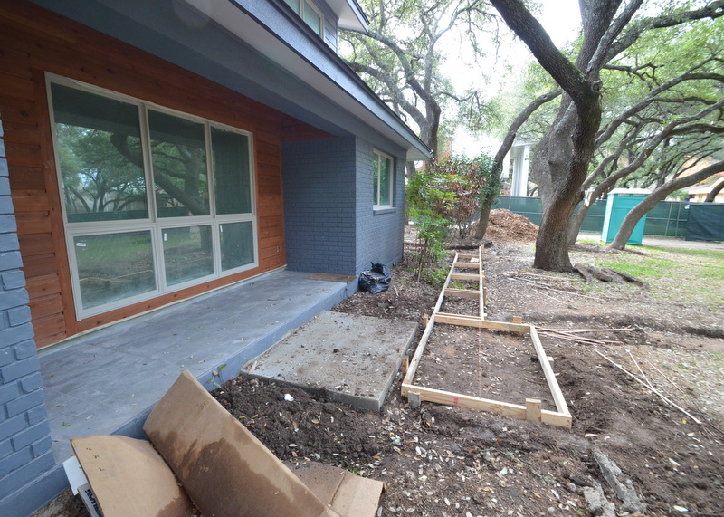 Gilsa extended the forms for the front walk, nearly to the 90-degree corner to the kitchen side door.