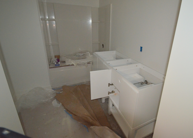 We used the same configuration -- two vanities with a bridge in the middle -- upstairs in bath 3.