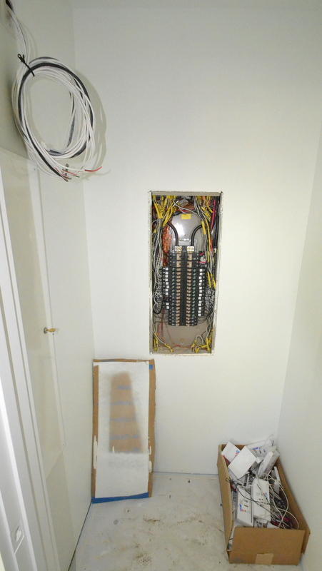 The electrical panel in the upstairs hall closet -- a work in progress.