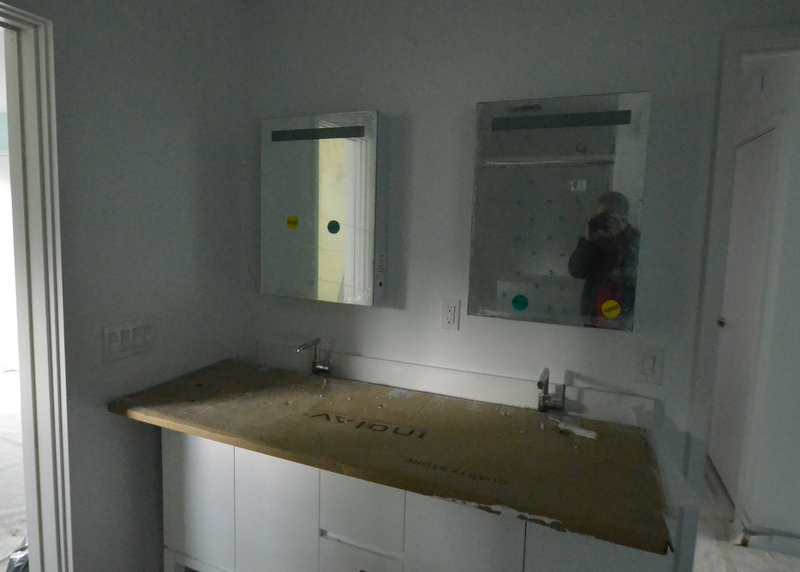 Ron and Jacinto from Ranserve installed the lighted mirror medicine cabinets in bath 2 -- Jadin's bath.