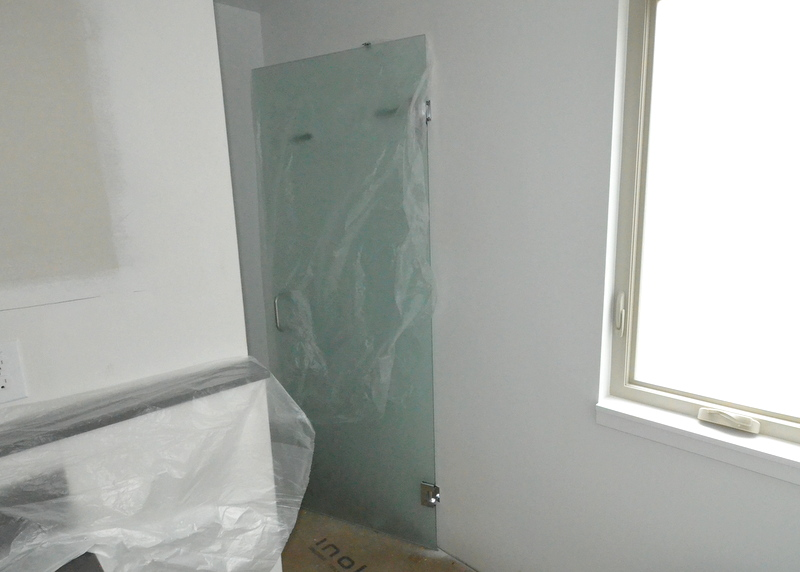 Binswanger Glass today delivered and installed the obscured glass door to the water closet in the master bath ...
