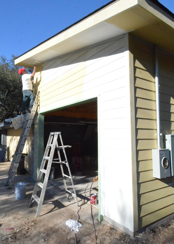 David Garcia began to apply primer to the new garage structure.