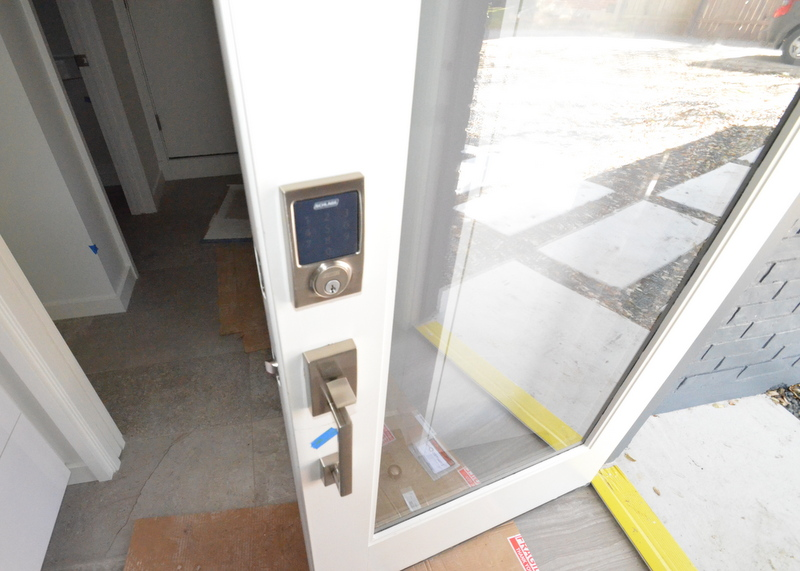 While Steven was traveling, Peter and Shane worked with Jacquela to shift the Schlage electronic lock and deadbolt to the side door off the kitchen -- the most-heavily used exterior door to the house.