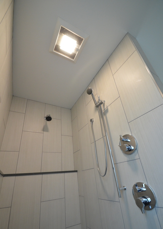 In the master shower, DJ installed the Panasonic LED light kit and grille.