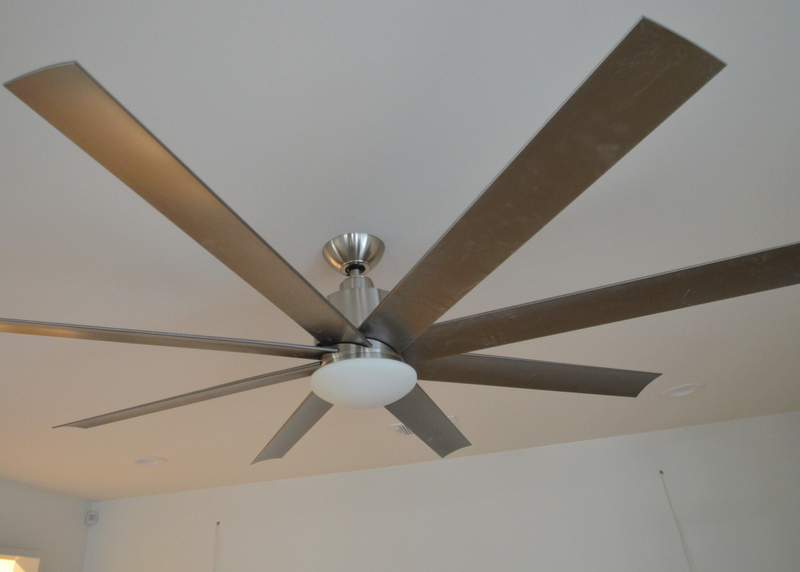 They also swapped out the long down rods on the ceiling fans for shorter posts that pull the fans closer to the ceiling. We no longer feel like we have to duck when walking under the fans. Here's the ceiling fan in the family room, now mounted with a three-inch rod, lifting the fan higher off the floor.
