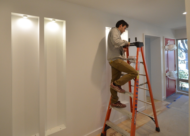 The second-coolest electrical thing to happen today is ... Steve and Beau installed the low-voltage puck lights in the four niches built into the entry hall. That's Beau on the ladder.