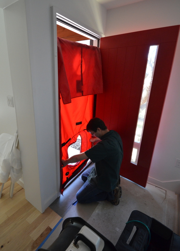Alex assembles the blower door.