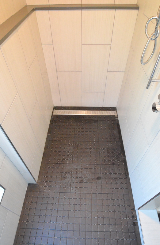 Thisi s a mock-up of what the floor will look like when done. Julian left the border on each side open, dry fitting the tile for full sheets to calculate how many more tiles he needs and how much cutting will be required.