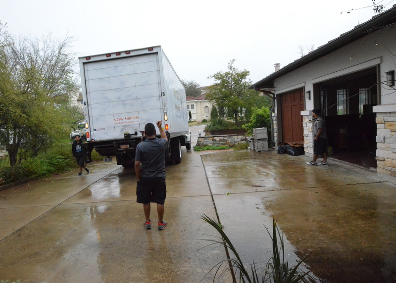 Moving van 1 of 3 backs down the driveway at Sea Eagle, approximately 830 am.