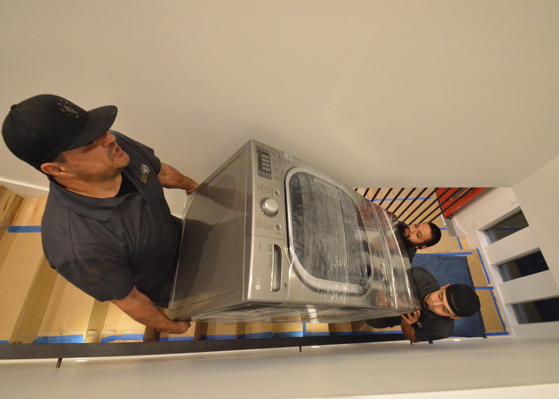 Vying for favorite photo of the day -- all the labor needed to lift the washer up the stairs to the second floor laundry.