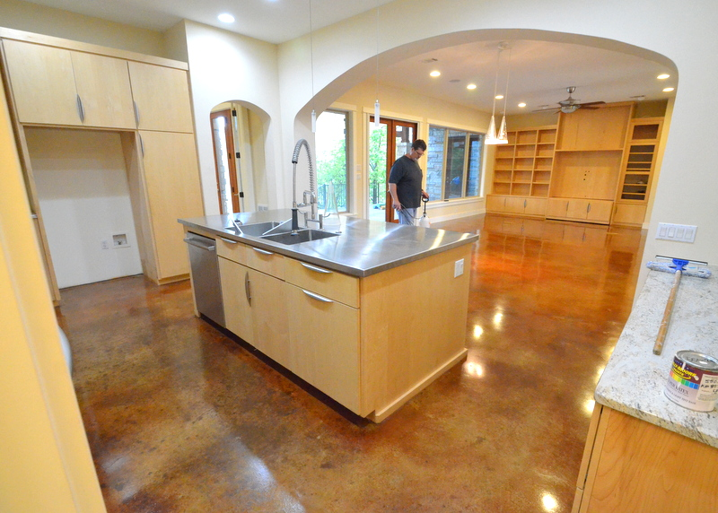A second shot of Trey at work, waxing and polishing the stained concrete for showing to potential buyers.