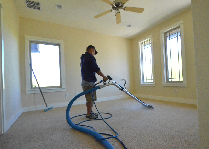 Sam at work on the carpet. He said it would take 45 minutes. And the carpet cleaned up well.